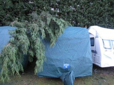 Caravan cover protects tourer from fallen tree