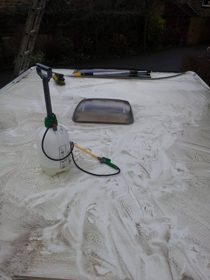 Caravan roof being cleaned