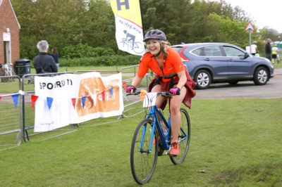Caravan Guard's Rebecca crosses the Great Yorkshire Bike Ride finish line