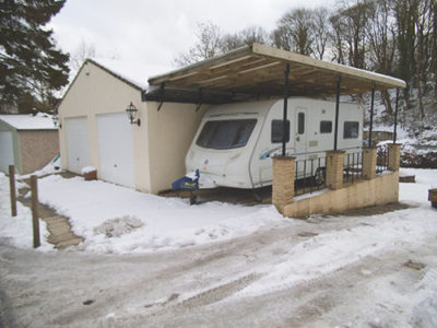 touring caravan snow winter carport
