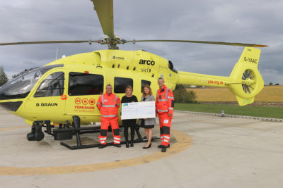 Caravan Guard present cheque to Yorkshire Air Ambulance