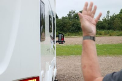 Give clear instructions when helping to reverse a motorhome